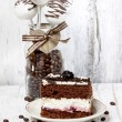 Chocolate and cherry cake on white plate. Cake pops in glass jar — Stock Photo