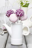 Pastel cake pops on rustic grey wooden table — Stock Photo