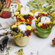 Candle holder decorated with autumn flowers and other plants — Stok fotoğraf