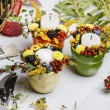 Candle holder decorated with autumn flowers and other plants — Foto de Stock