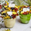 Постер, плакат: Candle holder decorated with autumn flowers and other plants