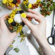 Florist at work. Woman making autumn floral decorations — Stock Photo