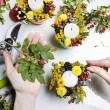 Florist at work. Wommaking autumn floral decorations — Stock Photo #30649461