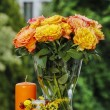 Bouquet of stunning orange roses in transparent glass vase — Stock Photo #30650997