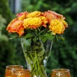 Stock Photo: Bouquet of stunning orange roses in transparent glass vase