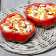 Red pepper stuffed with rice and vegetables on wicker tray. — Stock Photo