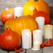 Halloween party decor. Beautiful orange pumpkins on wooden table — Stock Photo #30702511