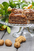 Pieces of nut cake on wooden table. — Stock Photo