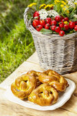 Homemade cookies on wooden table. Bouquet of autumn plants — Stock Photo