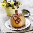 Baked apple decorated with cinnamon heart shape ornament — Stock Photo