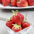 Fresh ripe strawberries in glass bowl — Stock Photo