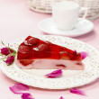 Piece of strawberry cake in pink romantic table setting — Stock Photo