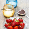 Fresh strawberries and cake pop in heart shape on wooden table.  — Stock Photo