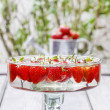 Strawberries floating in water. Party decoration — Stock Photo