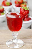 Strawberry drink on wooden table. Fresh, raw strawberries in the — Stock Photo