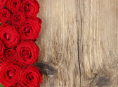 Stunning roses on wooden background. Copy space — Stock Photo