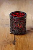 Oriental iron lantern on wooden table — Stock Photo