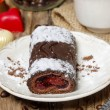 Swiss roll (roulade) with raspberries on white plate — Stock Photo #35529869