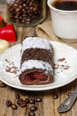 Swiss roll (roulade) with raspberries on white plate — Stock Photo
