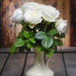 Stunning white roses in ceramic vase. Beautiful bouquet — Stock Photo #35532853