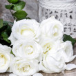 White roses on rustic wooden table — Stock Photo #35532587