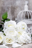 White roses on rustic wooden table — Stock Photo