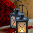 Beautiful iron lanterns on wooden table. Romantic mood, stunning — Stock Photo #37155731