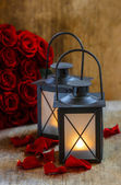 Beautiful iron lanterns on wooden table. Romantic mood, stunning — Stock Photo