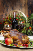 Roasted goose in autumn setting — Stock Photo