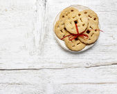 Top view of cookies with red bow on white wooden table — ストック写真