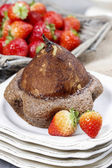 Pear in cake with chocolate sauce — Stock Photo