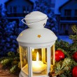Beautiful white lantern on snowy evening landscape. Christmas — Stock Photo