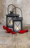 Beautiful iron lanterns on wooden table. Romantic mood, stunning — Stock Photo