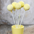 Yellow cake pops on wooden table — Stock Photo