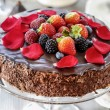 Chocolate cake with strawberries. Birthday party table — Stock Photo #38631889