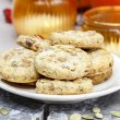 Pumpkin cookies in autumn setting — Stock Photo #38636469