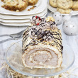Stock Photo: Sweet roll cake on transparent glass cake stand