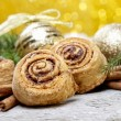 Cinnamon rolls in christmas setting — Stock Photo