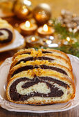 Poppy seed cake in golden christmas setting. Selective focus — Stock Photo
