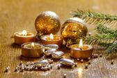 Beautiful golden candles. Christmas eve mood. Selective focus. — Stock Photo