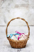 Easter wicker basket of eggs on grey background. Copy space — Stock Photo
