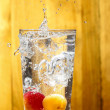 Water splash over glass. Apricot drink on hot summer day — Stock Photo #38641761