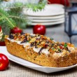 Fruitcake with dried fruits and nuts in christmas setting — Stock Photo #38814727