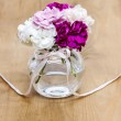 Bouquet of carnation flowers in glass vase on wooden table. Gold — Stock Photo #38817675