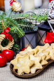 Homemade cookies in star shape on wooden table in christmas eve — Stock Photo