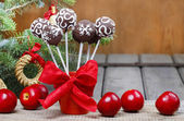 Chocolate cake pops in christmas setting — Stock Photo