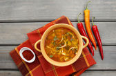 Top view on pot of tomato soup and fresh vegetables on old wood — Stock Photo