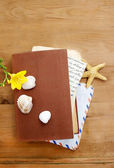 Diary, old letters and yellow freesia flower on wooden table. Ro — Stock Photo