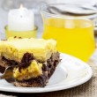 Piece of yellow and brown cake on wooden table. Selective focus — Stock Photo
