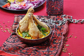 Indian cuisine: roasted chicken with rice and green peas — Stock Photo